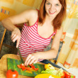 Stock Photo: Woman making salad