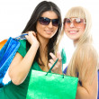 Girls with shopping bags — Stock Photo