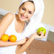 Girl at home with fruit — Stock Photo