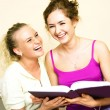 Two students reading a book — Stock Photo #1828260
