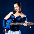 Girl playing the guitar — Stockfoto