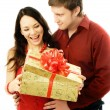 Stock Photo: Man giver a present to his wife