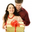 Man gives a present to his wife — Stock Photo #1828892