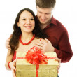Man gives a present to his wife — Stock Photo