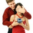 Man gives a present to his wife - Stockfoto