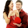 Man gives a present to his wife — Stock Photo #1828990