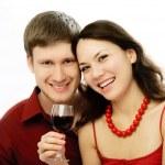 Happy couple drinking vine — Stock Photo