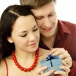 Young man gives a present to his girl — Stock Photo #1829034