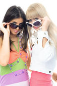 Girls trying on sun glasses — Stock Photo