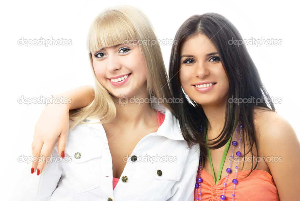 Portrait of two happy young embracing friends against white background — Stock Photo #1826731