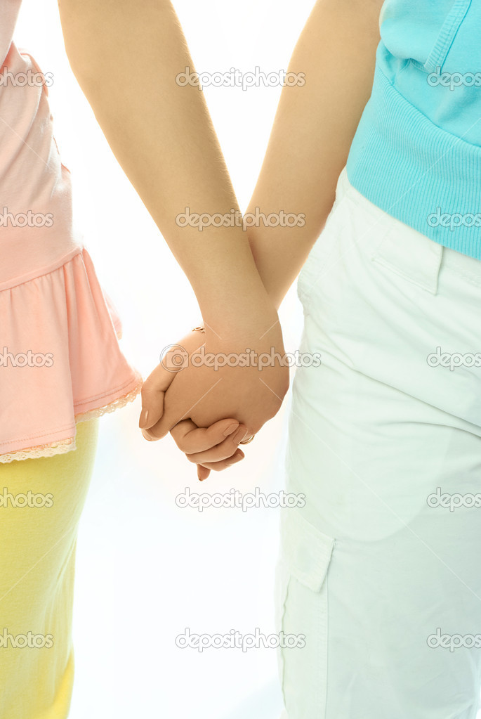 Two Women Holding Hands Two women hold hands - stock