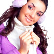 Pretty girl with earmuff - Stock Photo