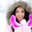 Stockfoto: Girl throwing a snowball