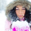 Girl blowing on the snow — Stock Photo