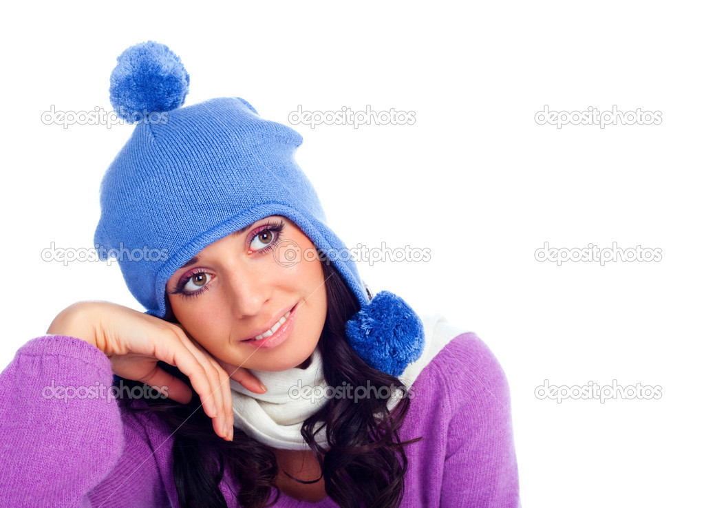 Pretty young dreamy brunette woman wearing a blue hat  Stock Photo #1845798