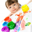 Little girl painting with finger paints — Stock Photo