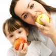 Stock Photo: Mother and daughter eating apples