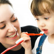 Mother and daughter brushing teeth — Stock Photo #1871221