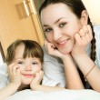Mother and daughter on the bed — Stock Photo #1871252