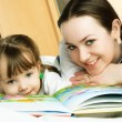 Mother and daughter reading a book — Stock Photo #1871275