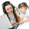 Mother and daughter with a laptop — Stock Photo