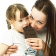 Royalty-Free Stock Photo: Mother and daughter eating chocolate