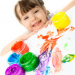 Happy girl painting with finger paints — Stock Photo