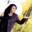 Happy girl with an umbrella - Stock Photo