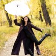 Stock Photo: Happy girl with an umbrella