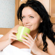 Beautiful woman drinking coffee in bed — Stock Photo #1872368