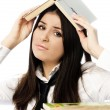 Unhappy student doing homework - Stock Photo