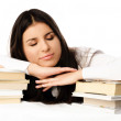 Beautiful student sleeping on the table — Stock Photo