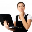 Thoughtful woman with a laptop — Stock Photo