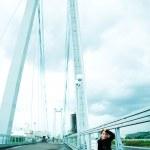 Lonely girl on the bridge — Stock Photo