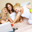 Three girls with a laptop — Stock Photo