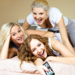 Stockfoto: Three freinds watching TV