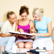Royalty-Free Stock Photo: Three students at home