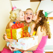 Three girls celebrating birthday - Stock Photo