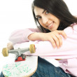 Teenage girl with a skate board — Stock Photo
