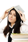 Unhappy student doing homework — Stock Photo