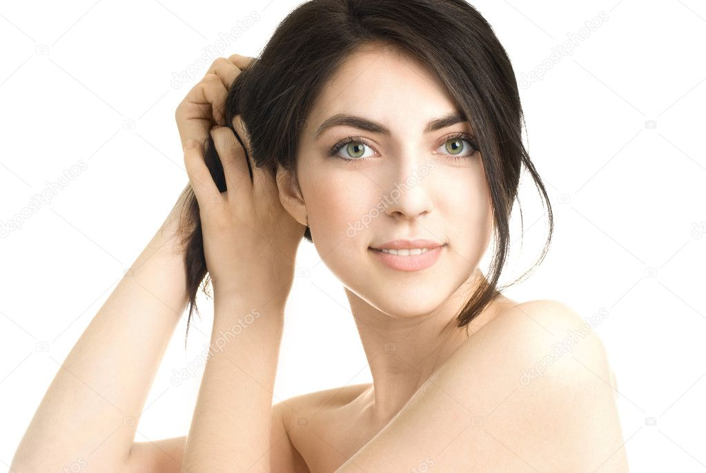 Portrait of a beautiful young brunette woman touching her hair — Stock Photo #1874146