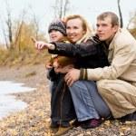 Happy family near the lake — Stock Photo