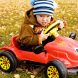 Boy driving  a car - Stock Photo