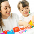 Mother and daughter painting — Stock Photo