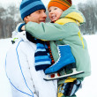 Father and son go ice skating — Stock Photo