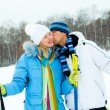 Happy couple skiing - Stock Photo