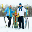 Stock Photo: Happy family skiing