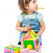 One year old girl playing with her toys — Stock Photo