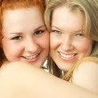 Two happy embracing friends — Stock Photo