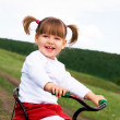Royalty-Free Stock Photo: Cute two-year old girl riding a bysicle